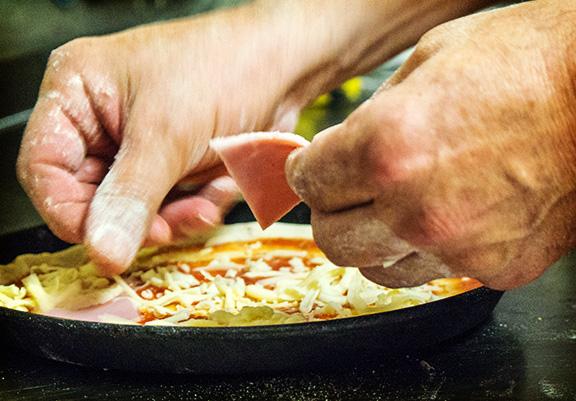 Pizza-belegen